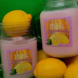 mason jar filled with pink wax to make it look like a drink and lemons in the background