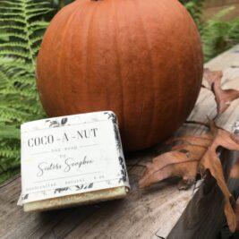 Coco-A-Nut Bar soap leaning against a pumpkin