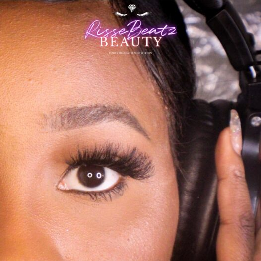 Lash style Tay depicted on music artist Charisse Sky in studio booth with headphones