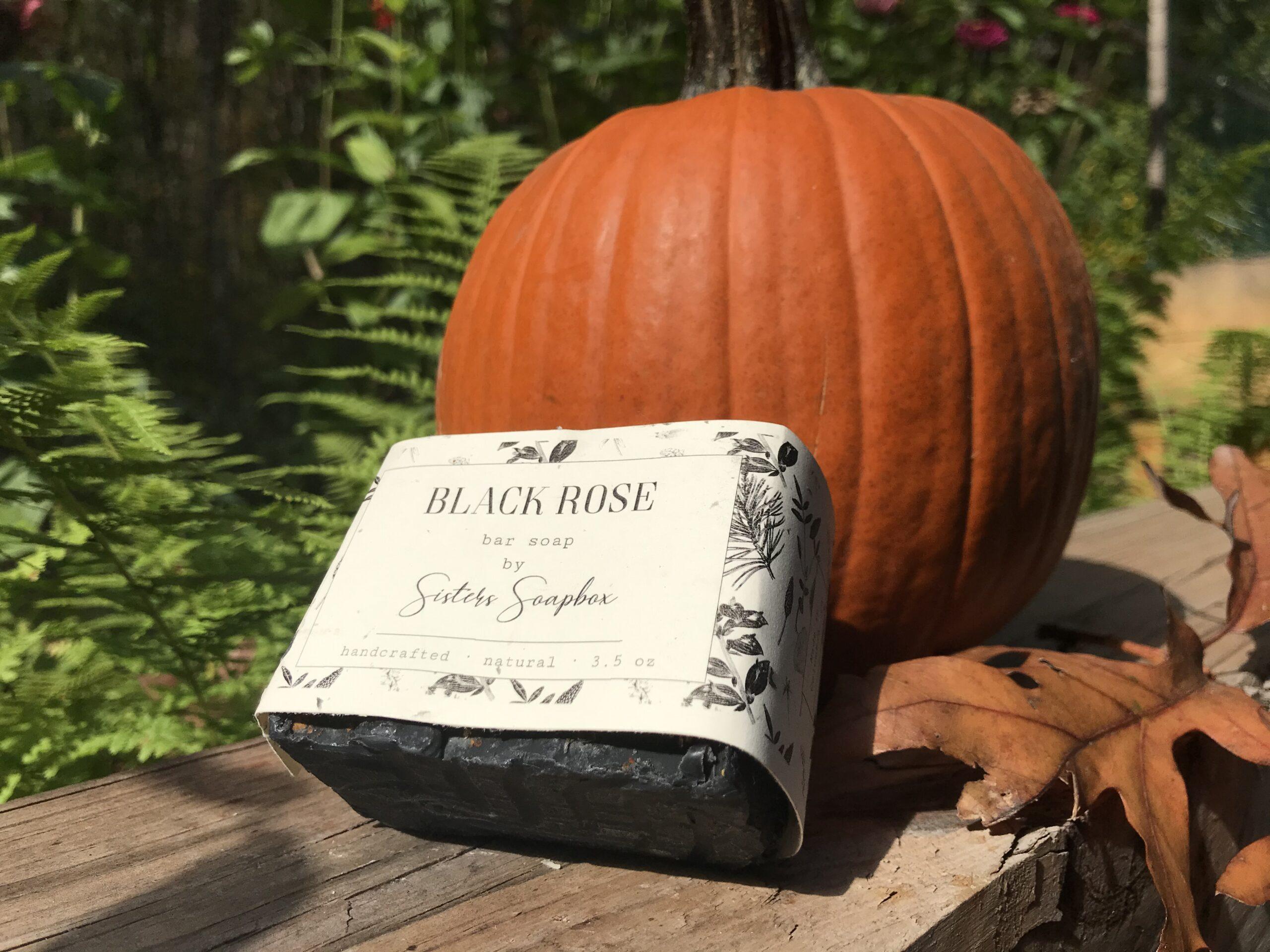 Black Rose soap leaning against a pumpkin