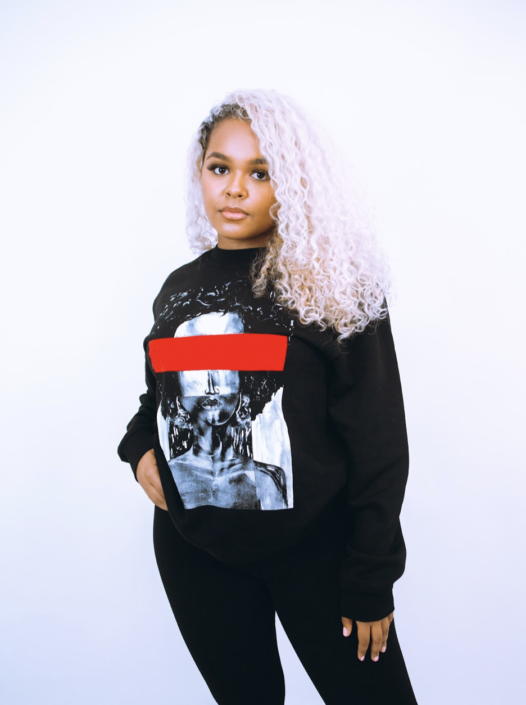 Female wearing Black sweatshirt with monochrome design and red feature